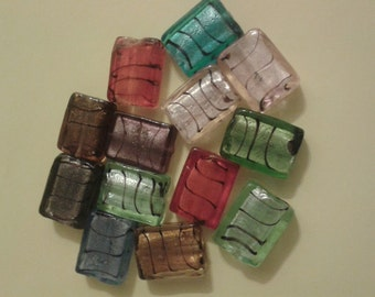 13 multicoloured rectangular glass beads with stripe detail, 1cm by 2cm