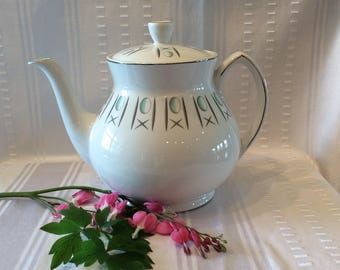Lovely vintage WH Grindley teapot satin white trade mark mid century ceramic Hugs and kisses pattern
