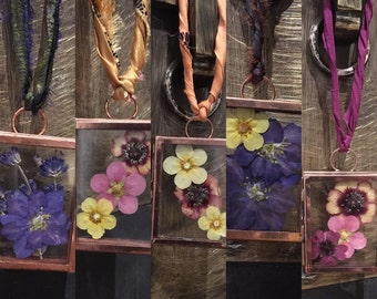 Beautiful pressed flowers displayed in miniture copper glass hanging frame.Wall hanging decor. Dried flowers. Display frame. Glass frame.