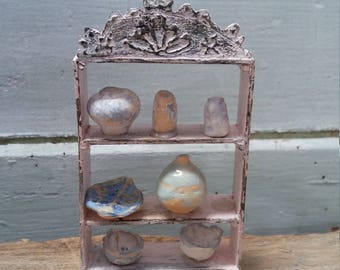 OOAK collection of ceramics on a wooden rack