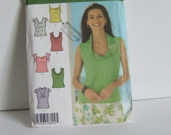 Uncut Simplicity sewing pattern 4539 misses knit tops with sleeve and neckline variations casual shirts for women ladies wear sizes 14 to 22