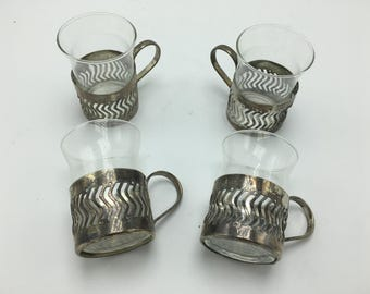 Vintage espresso demi cups with silver tone holders.