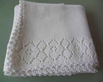 White baby blanket with lace pattern