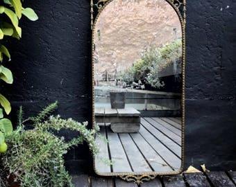 Ornate brass framed mirror