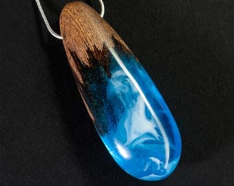 Smoke on the water - blue resin and mahogany pendant
