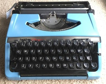 WORKING (minus one function) TESTED CLEANED Vintage Brother Correction Charger 11 Blue Manual Typewriter