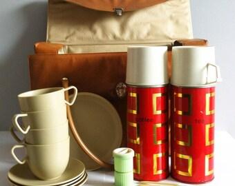 Retro Picnic hamper set, 1960's, flasks, melamine plates, cups, saucers, salt, pepper set, spoons, vinyl bag.