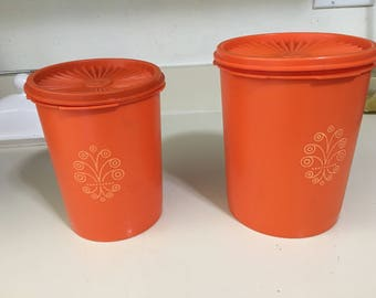 Vintage Tupperware canisters with gold design on front