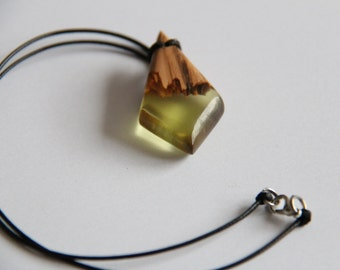 Pendant / wooden necklace and yellow resin