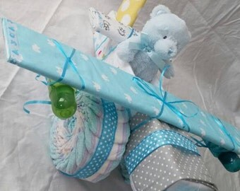 Large diaper cake airplane with teddy bear pilot