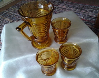 Vintage glass water jug with glasses