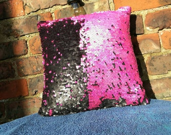Hot pink and matte black two tone sequin cushion