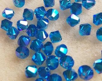 Swarovski Xilion bicone Capri Blue Aurore Boreale (AB) 4mm