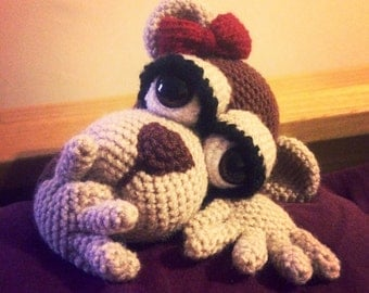 Crochet monkey with a bow