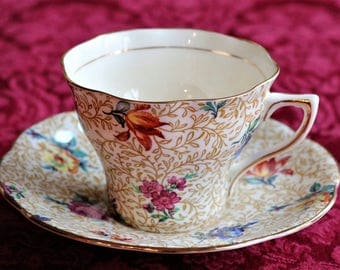 Floral Chintz with Bright Flowers, Tan Background, Gold Accents - Rosina Bone China Tea Cup and Saucer