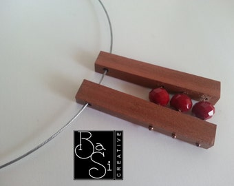 Pendant cherry wood with dark red crystals