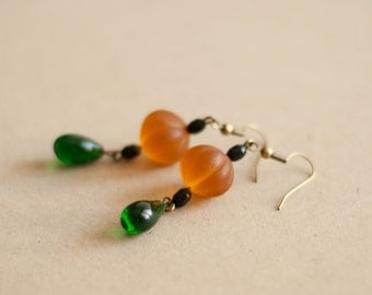 Vintage earrings made of old glass beads, green and orange