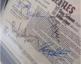 The Beatles ' Twist and Shout' EP framed with all four signatures