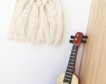 Modern dollhouse miniature guitar