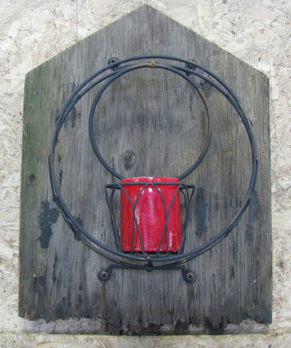 Candle holder for wall mounting