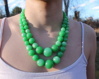 Double strand pearly green plastic bead necklace, costume jewelry, 1970s