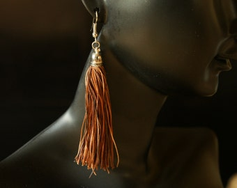 Hand made toffee leather tassel earrings Gyppo & Glitterati from France.
