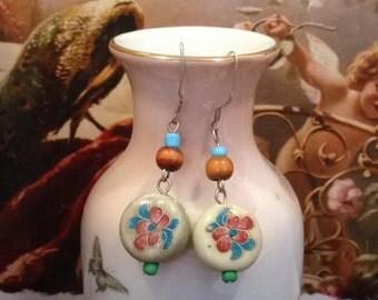 Handmade oriental flower ceramic and sterling silver drop earrings.