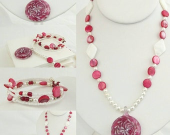 Red and white beaded necklace with glass pendant and matching bracelet