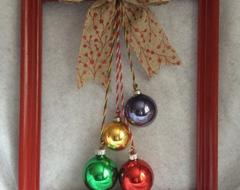 Frames with hanging glass ornaments