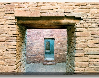 Ancient stone brown walls and doors at the Pueblo Bonito Ruin at Chaco Canyon, NM.  Wall art photograph print on a gallery wrapped canvas.