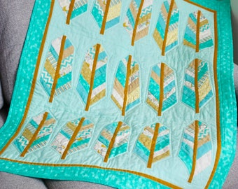 Feather design patchwork cot quilt