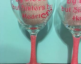 Sisters by heart glittered wine glass