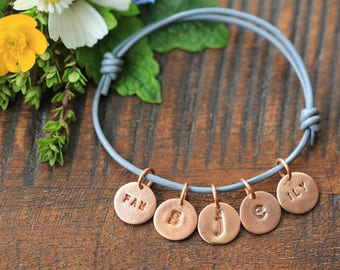 Handmade Copper Family initial Charm bracelet on a genuine grey leather bracelet