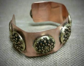 Copper and brass cuff bracelet.