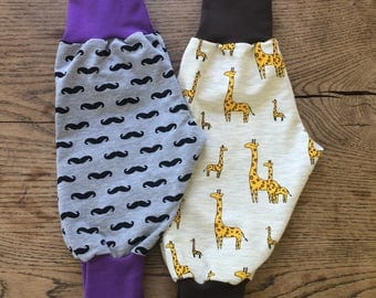 Cotton french terry harem pants in giraffe and moustache print