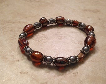 Bronze and silver beaded stretchy bracelet