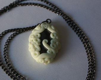 Hematite wrapped in glow-in-the-dark tentacle necklace
