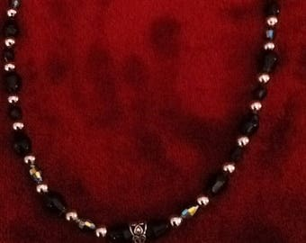 "Beaded necklace,black, black foiled and silver beads w/ focal which reads"" Believe"