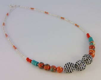 Hand beaded necklace in coral, turquoise, and silver
