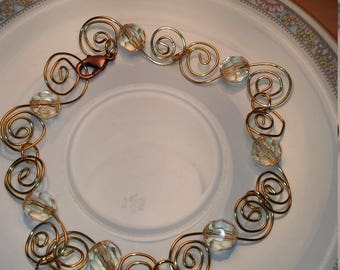 Light to clear yellow beads with gold metal swirls
