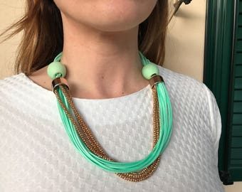 Short elegant necklace in light green color perfect for really chic appearances.