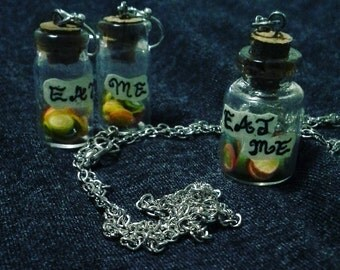 """Alice in Wonderland """"Eat Me"""" necklace and earrings set"""