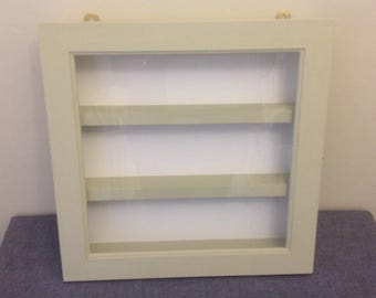 Display cabinet painted in chalk paint