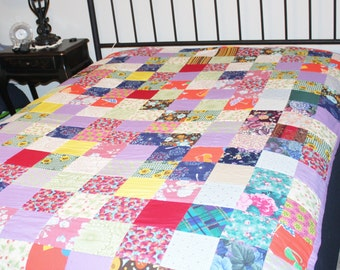 Hand sewn twin size extra long quilt.  Fleece backing.
