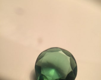 Round faceted bright green tourmaline
