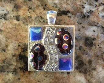 Square faux silver pendant with glass beads; grouted