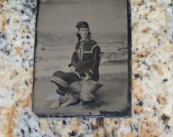 Seashore Sweetie:  Antique Tintype Photograph of Woman in Bathing Suit/Costume Posing in a Seaside Studio Set