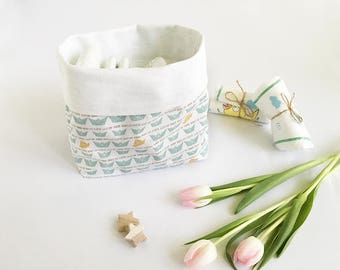 Soft fabric storage container with azure boats