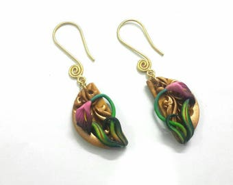 Golden polymer clay lily earrings.