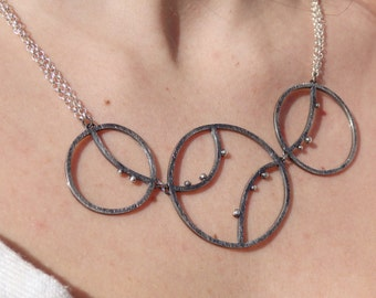 Necklace silver asymmetric circles, single piece